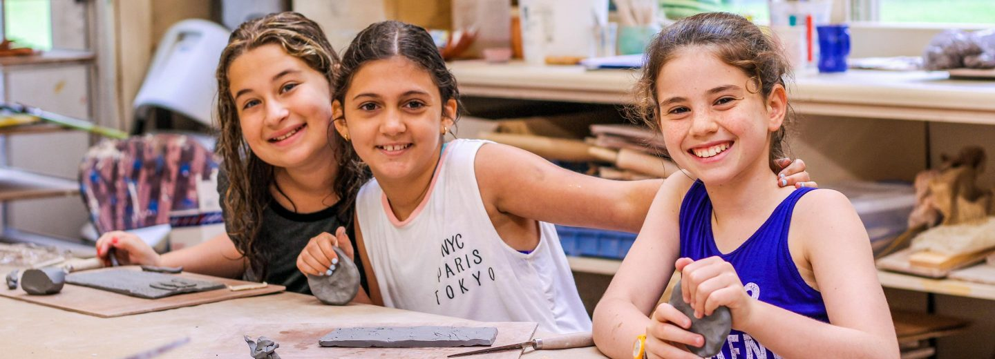 Girl campers at arts and crafts