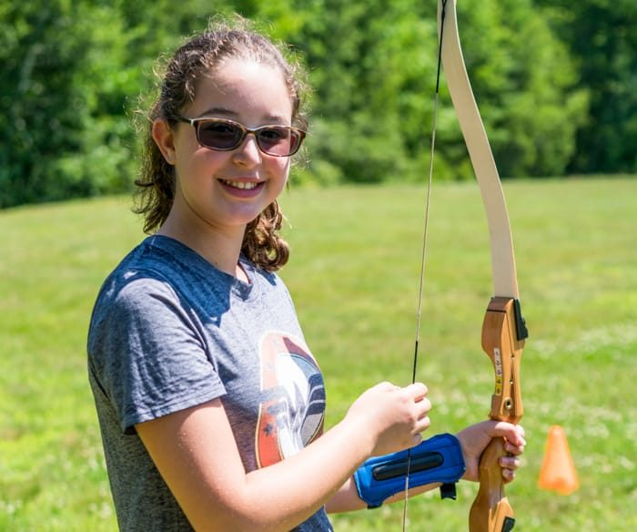 Girl holding archery bow