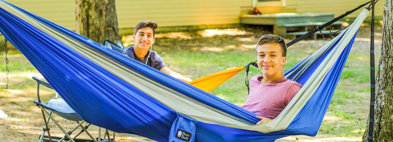 Boy campers in hammocks