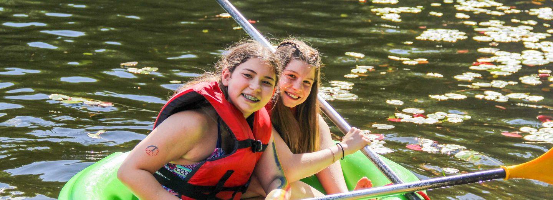 Girls in boat with oars