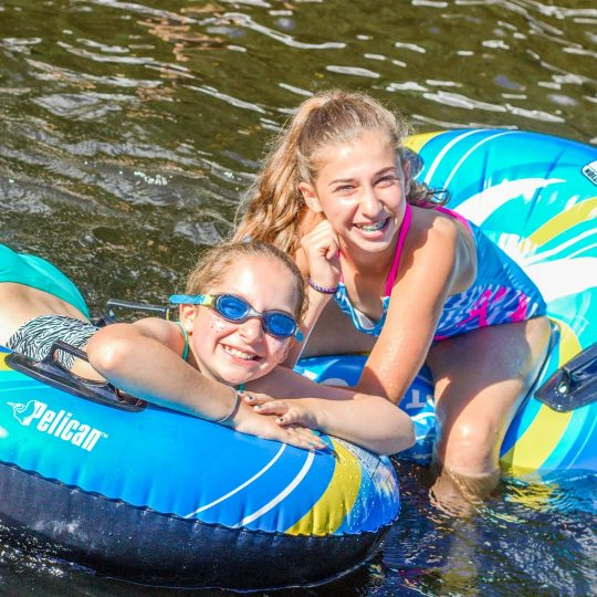 Girls on lake with inflatable rafts